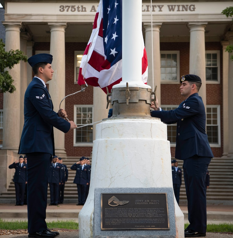 Airmen raise flag to half-staff