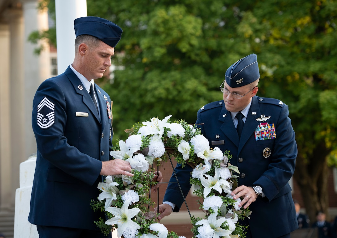 Airmen carry wreath