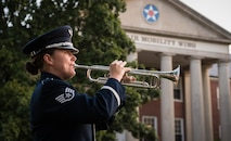 Staff. Sgt. plays taps