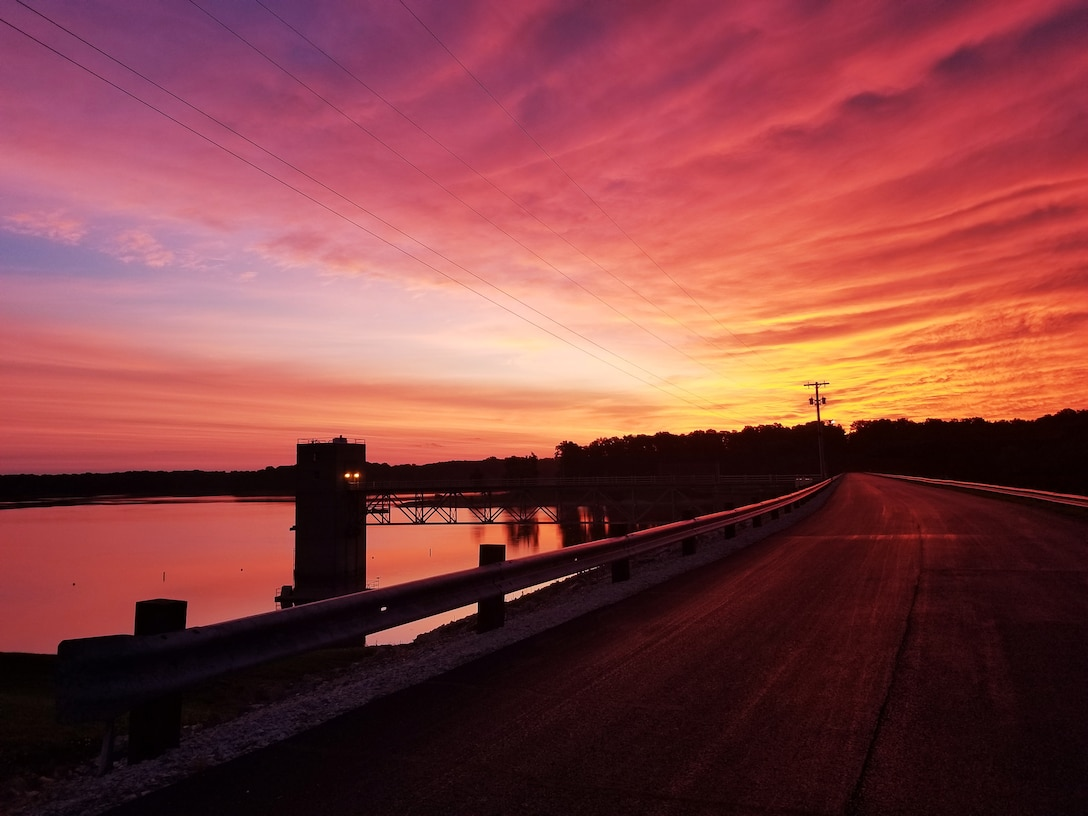 A warm sunrise over Cecil. M Harden Dam in Rockville, Indiana. (USACE photo by Chris DeSmit)