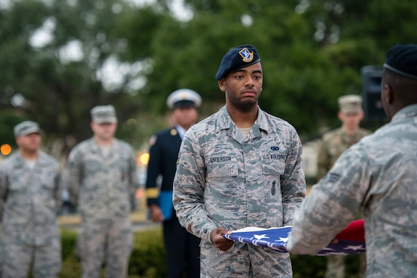 Airman 1st Class Jalen Anderson folds a flag during a 9/11 remembrance ceremony Sept. 11 at Joint Base San Antonio-Randolph. The event honored those who lost their lives during terrorist attacks in New York City, Washington D.C. and Pennsylvania 18 years ago.