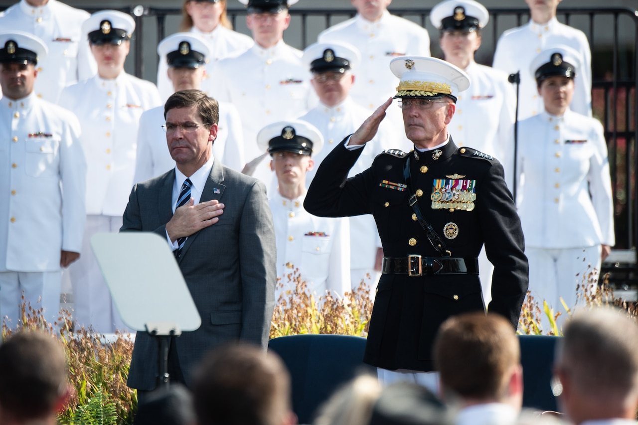 Defense Secretary Dr. Mark T. Esper and Marine Corps Gen. Joe Dunford, chairman of the Joint Chiefs of Staff, stand next to each other.