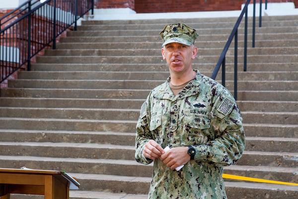 Norfolk Naval Shiphard's Public Works Officer Cmdr. William Butler speaks at the ribbon cutting of Bldg. M-32 Aug. 22.