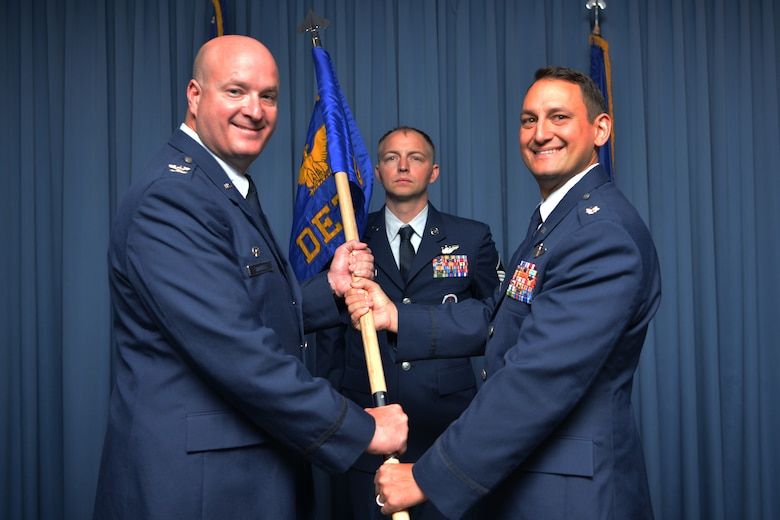 U.S. Air Force Lt. Col. Brian R. Dicks (right), 58th Operations Group Detachment Two commander, receives command of the 58th OG Det. Two from U.S. Air Force Col. Richard Carrell, 58th Operations Group commander, during the 58th OG Det. Two activation and assumption of command ceremony at Kirtland Air Force Base, N.M., Aug. 23, 2019. The detachment will be responsible for validating training, ensuring appropriate facilities and equipment are available and standing up formal training for the rotary-wing personnel recovery platform for the new HH-60W Combat Rescue Helicopter. (U.S. Air Force photo by Staff Sgt. Dylan Nuckolls)
