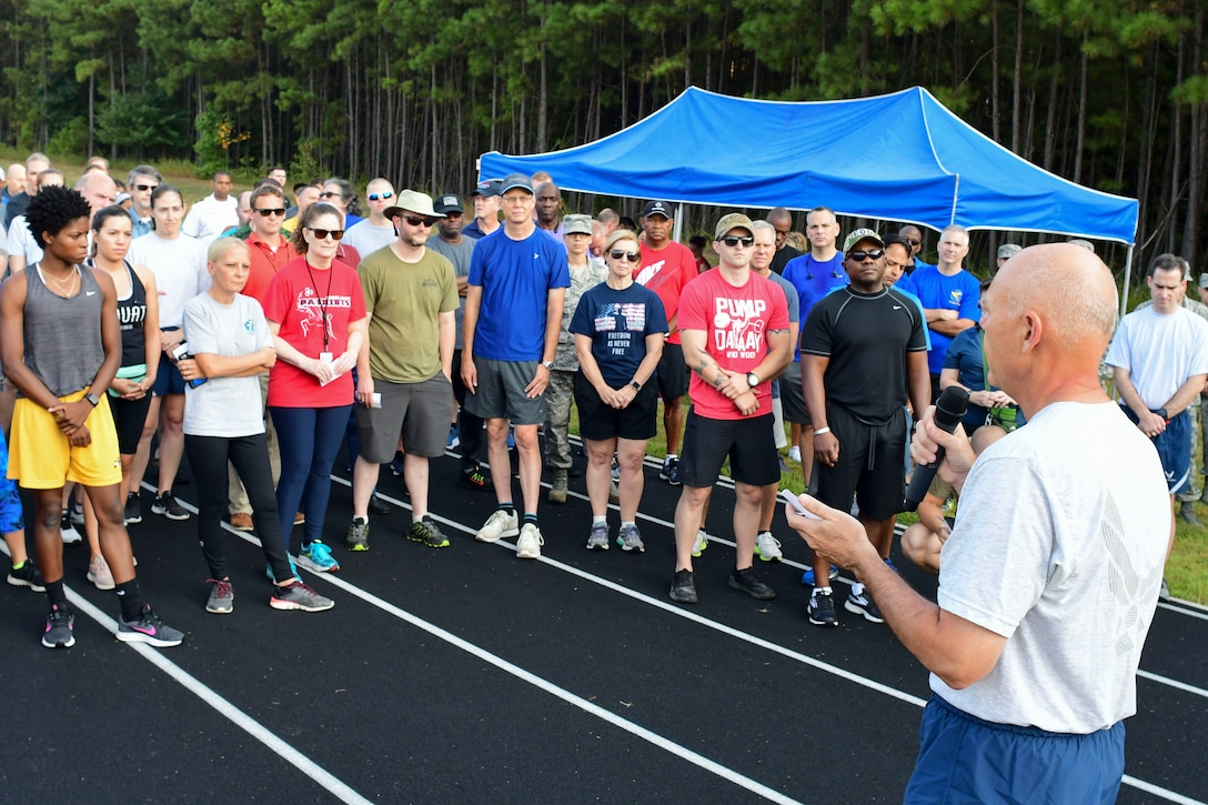 Brig. Gen. Richard Kemble, 94th Airlift Wing commander, gives the opening remarks at this year's Sept. 11 Memorial Walk at the base track, Sept. 11, 2019.