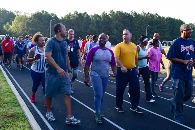 Participants in this year's Sept. 11 Memorial Walk talk with each other as they walk one mile around the base track Sept. 11, 2019 to honor those lost during the terrorist attack.