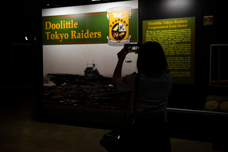 Airman 1st Class Brittany Parsons, 90th Comptroller Squadron financial operations technician, takes a picture of the Doolittle Raid exhibit in The National Museum of the U.S. Air Force Sept. 4, 2019, at Wright-Patterson Air Force Base, Ohio. The museum is 19 acres of indoor viewing space, making it the worlds largest aviation museum. (U.S. Air Force photo by Senior Airman Abbigayle Williams)