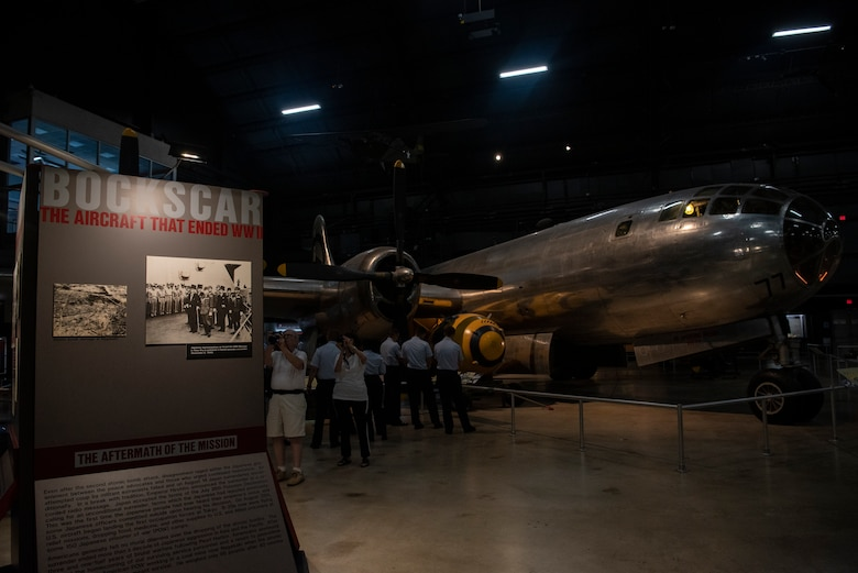"""Airmen from the 90th Missile Wing views the B-29 Superfortress """"Bockscar"""" exhibit within the National Museum of the U.S. Air Force Sept. 4, 2019, at Wright-Patterson Air Force Base, Ohio. Bockscar was the plane that dropped the atomic bomb on Nagasaki. (U.S. Air Force photo by Senior Airman Abbigayle Williams)"""