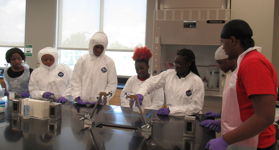 Students attending STEMversity in Milledgeville, Ga., work on a lab experiment with the help of Airman from the Air Force Technical Applications Center.  Each year, volunteers from the nuclear treaty monitoring center at Patrick AFB, Fla., provide expertise in the fields of science, technology, engineering and math to the summer campers at Central Georgia Technical College.  (U.S. Air Force photo by Stephanie Homitz)