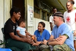 U.S. Navy LT Austin Stokes and U.S. Air Force Maj. Nicole Smith, both Pacific Angel 19-4 dentists, talk to a patient at the PAC ANGEL 19-4 health outreach site in Lae, Papua New Guinea Sept. 8, 2019. The health outreach site is comprised of five clinics including primary care, optometry, dental, physical therapy and pharmacy.