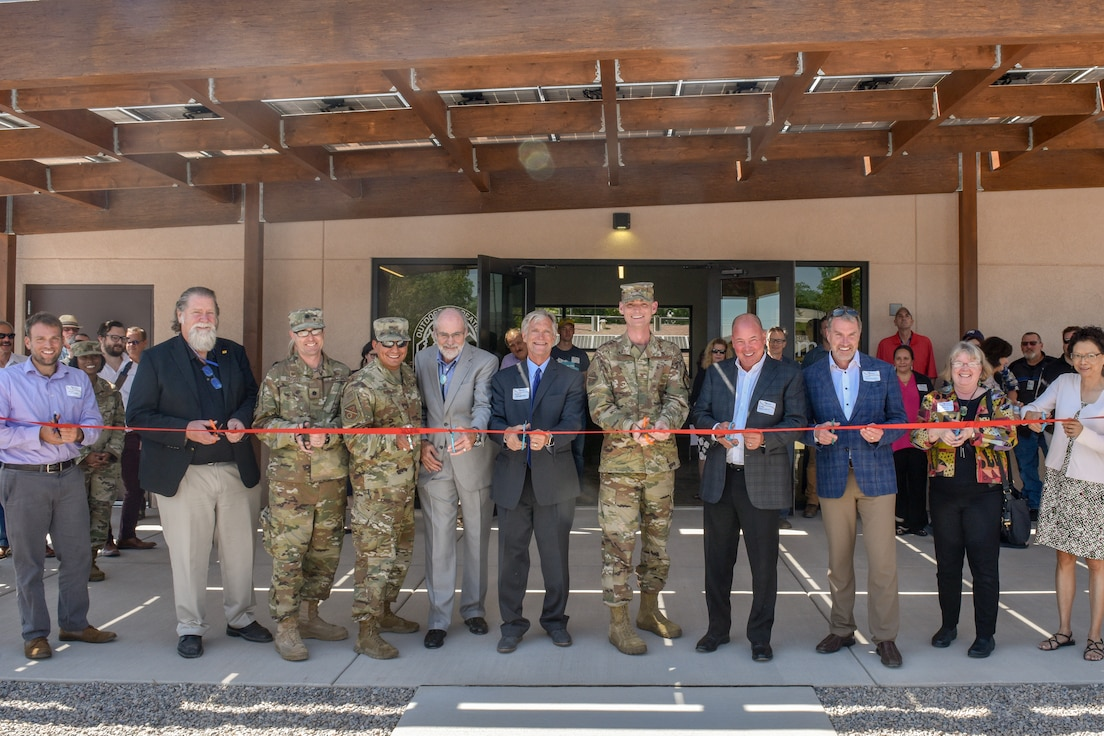 Leaders over the Gathering Place project cut a ribbon during a ceremony at Kirtland Air Force Base, N.M., Sept. 6, 2019. The Gathering Place hosts an advanced, renewable energy microgrid powered by solar panels that generates and distributes energy independently of the main power grid powering eight different building near Kirtland's Family Camp. (U.S. Air Force photo by Airman 1st Class Austin J. Prisbrey)