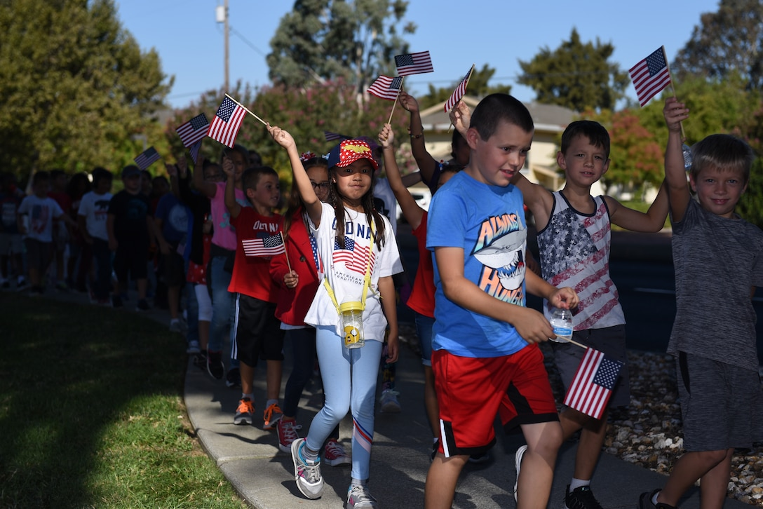 Children participate in the Remembrance Day Freedom Walk Sept. 11, 2019, at Travis Air Force Base, California. The walk commemorated those who lost their lives on 9/11. (U.S. Air Force photo by Airman 1st Class Cameron Otte)
