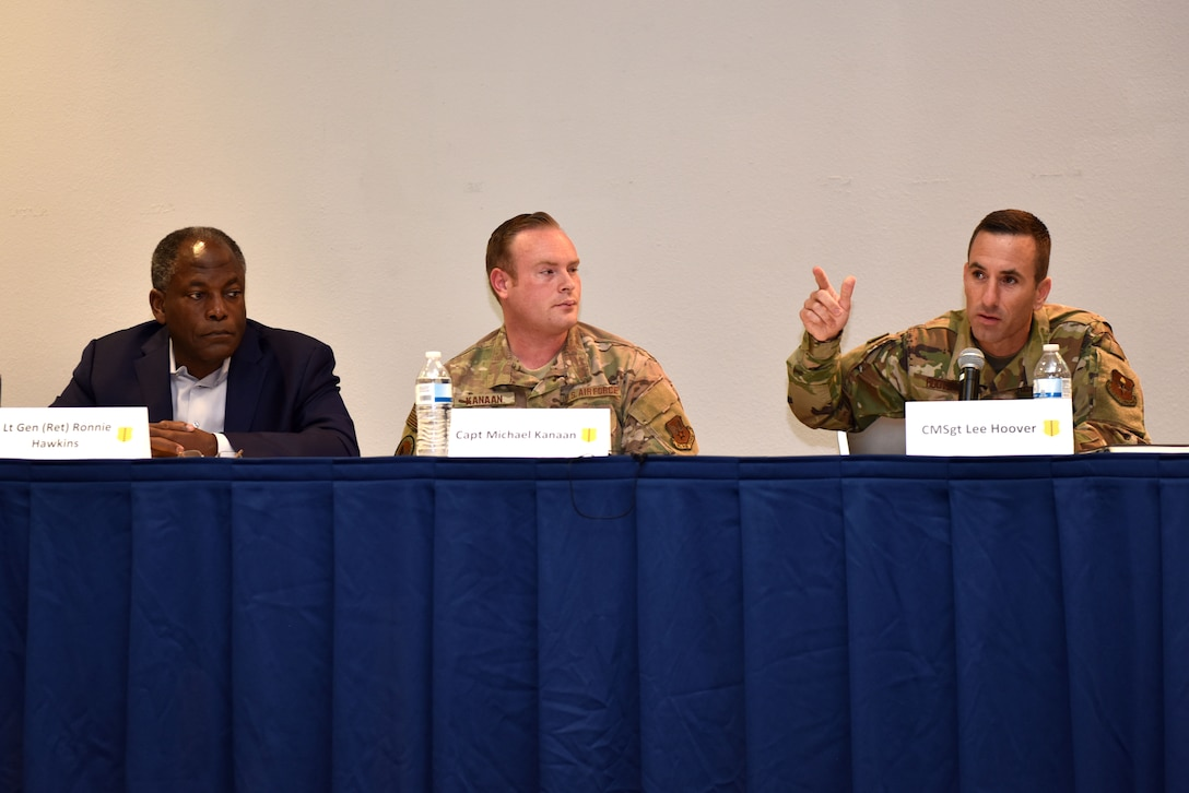U.S. Air Force Lt. Gen. retired Ronnie Hawkins, Capt. Michael Kanaan Air Force co-chair for artificial intelligence, and Chief Master Sgt. Lee Hoover, senior enlisted leader of basic military training, speak at the Future of the Air Force Symposium at the event center on Goodfellow Air Force Base, Texas, September 6, 2019. They spoke on topics such as infrastructure, artificial intelligence and tomorrow's Airmen. (U.S. Air Force photo by Senior Airman Seraiah Wolf/Released)