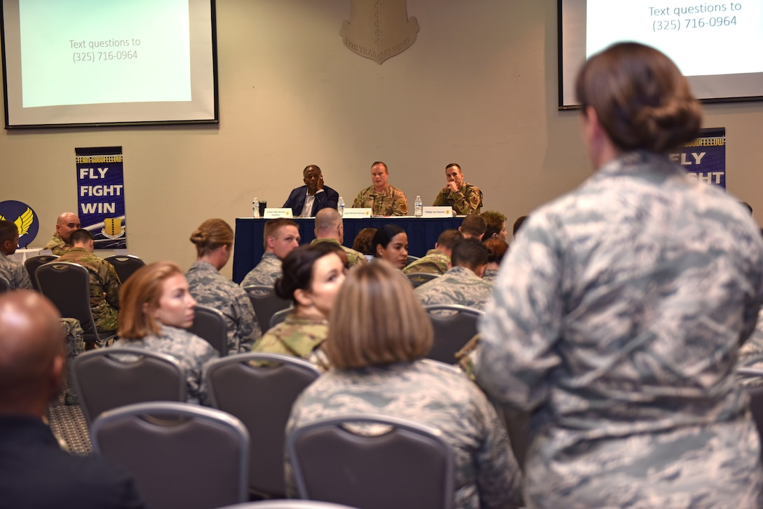 A member of the audience asks a question at the Future of the Air Force Symposium at the event center on Goodfellow Air Force Base, Texas, September 6, 2019. The panel members answered questions from the audience about topics relating to their career and the possibilities in store for the future. (U.S. Air Force photo by Senior Airman Seraiah Wolf/Released)
