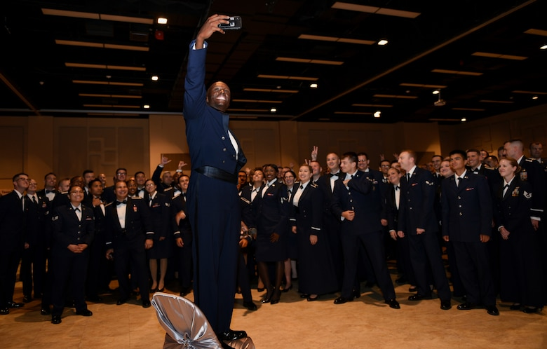 U.S. Air Force Chief Master Sgt. Lavor Kirkpatrick, 17th Training Wing command chief, takes a selfie with Goodfellow personnel at the 2019 Air Force Ball at the McNease Convention Center in San Angelo, Texas, September 7, 2019. The ball was a way to CONNECT with each other, as we GROW together and GO towards our future. (U.S. Air Force photo by Airman 1st Class Robyn Hunsinger/Released)