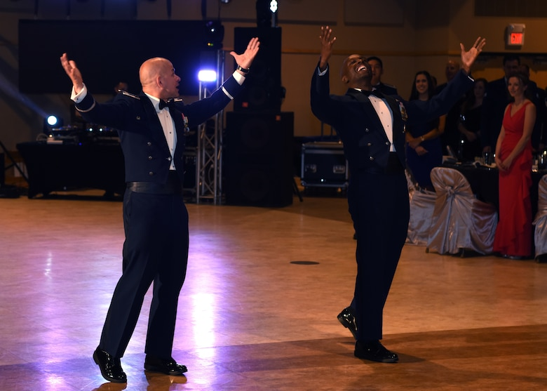 U.S. Air Force Col. Andres Nazario, 17th Training Wing commander, and Chief Master Sgt. Lavor Kirkpatrick, 17th Training Wing command chief, make an entrance at the 2019 Air Force Ball at the McNease Convention Center in San Angelo, Texas, September 7, 2019. The Air Force Ball's theme was The Future of the Air Force. (U.S. Air Force photo by Airman 1st Class Ethan Sherwood/Released)