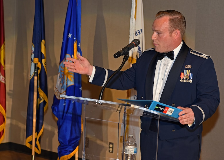 U.S. Air Force Capt. Michael Kanaan, Air Force co-chair for artificial intelligence, speaks on the future of AI and the Air Force at the 2019 Air Force Ball at the McNease Convention Center in San Angelo, Texas, September 7, 2019. Kanaan compared the AI race to the space race between the U.S. and Russia. (U.S. Air Force photo by Airman 1st Class Ethan Sherwood/Released)