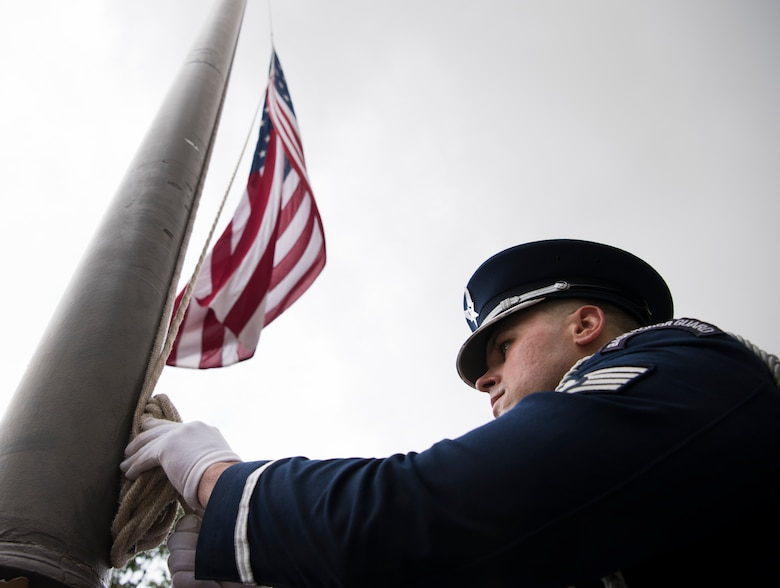 Staff Sgt. Christopher Johnson, 47th Flying Training Wing Honor Guard NCO in charge, secures the flag at half-staff during a 9/11 memorial ceremony at Laughlin Air Force Base, Teas, Sept. 11, 2019. The ceremony paid respect to the nearly 3,000 people who were killed in the terror attacks on Sept. 11, 2001. (U.S. Air Force photo by Staff Sgt. Benjamin N. Valmoja)