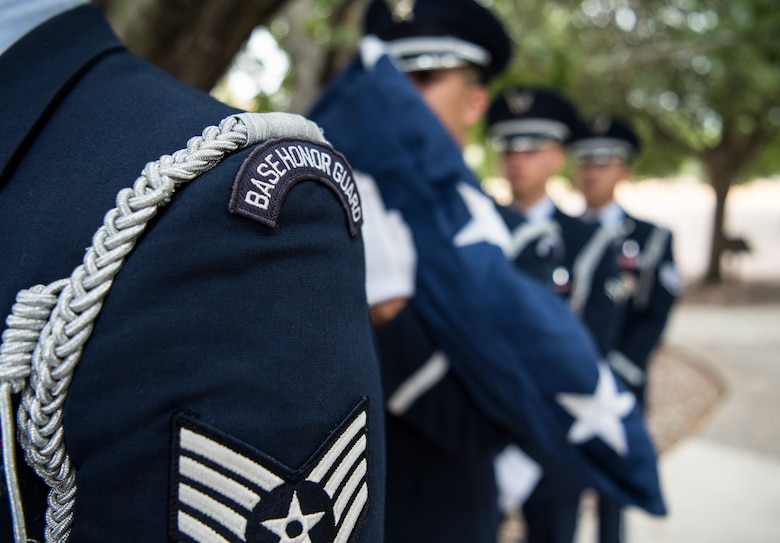 Laughlin Base Honor Guard members prepare to participate in a 9/11 memorial ceremony at Laughlin Air Force Base, Texas, Sept. 11, 2019. The flag was raised, then posted at half mast in remembrance of the nearly 3,000 people killed in the attacks of Sept. 11, 2001. (U.S. Air Force photo by Staff Sgt. Benjamin N. Valmoja)