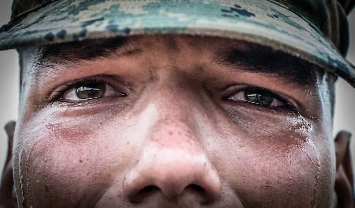 A recruit with Alpha Company, 1st Recruit Training Battalion, prepares to receive his Eagle, Globe, and Anchor, after the Crucible at Marine Corps Base Camp Pendleton, California Aug. 29.