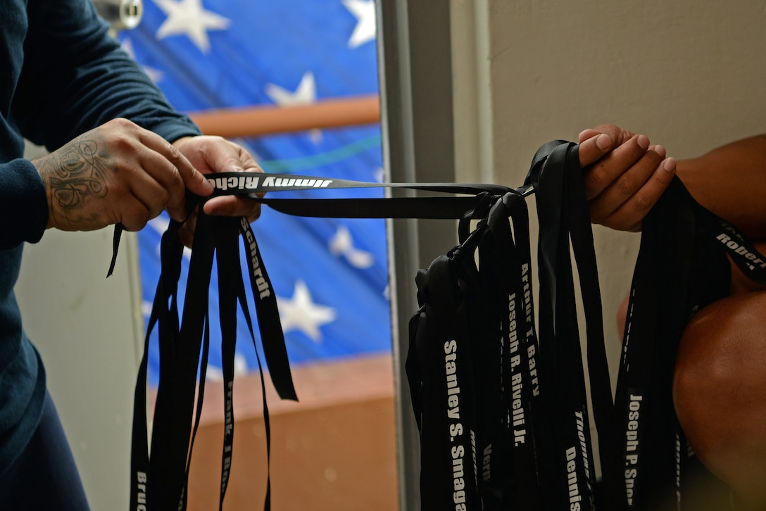 Ribbons labeled with one of the fallen fire fighters is clipped onto a ring during a September 11 memorial stair climb event on Andersen Air Force Base, Guam, Sept. 11, 2019.