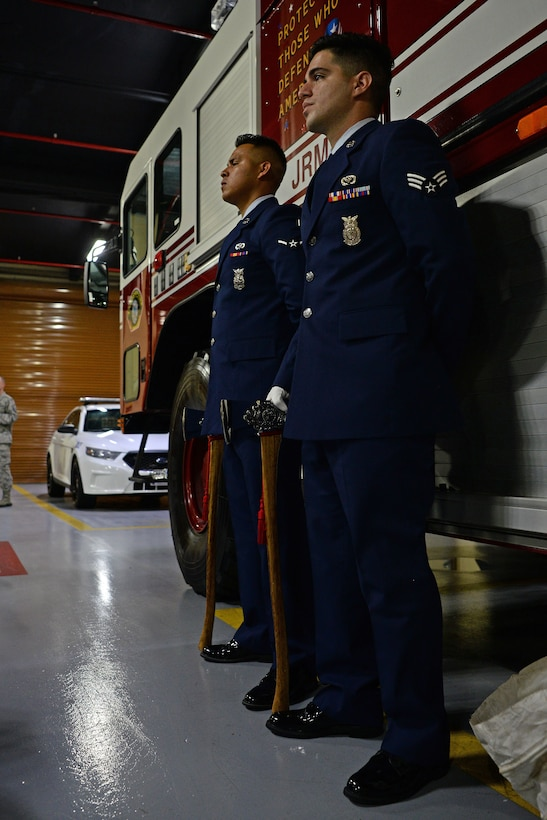 Two 36th Civil Engineer Squadron firefighters stand at attention during a September 11 memorial ceremony on Andersen Air Force Base, Guam, Sept. 11, 2019.