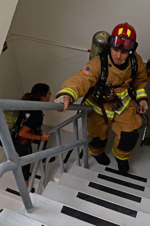 A 36th Civil Engineer Squadron firefighter climb the stairs of the 36th Operation Support Squadron air traffic control tower during a September 11 memorial stair climb event on Andersen Air Force Base, Guam, Sept. 11, 2019.