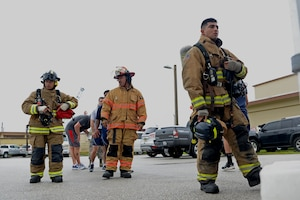 Members of the 36th Civil Engineer Squadron fire department wait to climb the 36th Operation Support Squadron air traffic control tower during a September 11 memorial stair climb event on Andersen Air Force Base, Guam, Sept. 11, 2019.