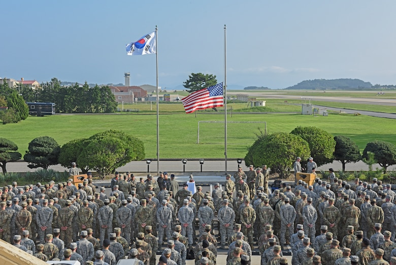 Members of the 8th Fighter Wing prepare for the September 11 Remembrance ceremony at Kunsan Air Base, Republic of Korea, Sept. 11, 2019. The ceremony was held in remembrance of the 2,977 people who lost their lives on Sept. 11, 2001, in New York City, Washington, D.C., and outside Shanksville, Pennsylvania. (U.S. Air Force photo by Staff Sgt. Mackenzie Mendez)