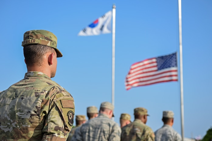 Airman 1st Class Rodney Pfahler, 8th Logistics Readiness Squadron member, stands at parade rest during the September 11 Remembrance ceremony at Kunsan Air Base, Republic of Korea, Sept. 11, 2019. The ceremony was held in remembrance of the 2,977 people who lost their lives on Sept. 11, 2001. (U.S. Air Force photo by Staff Sgt. Mackenzie Mendez)