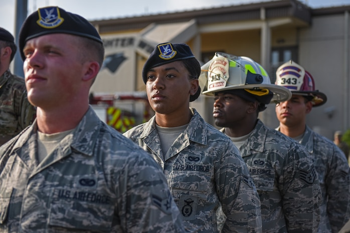 Airman 1st Class Aubrey Mathis, 8th Security Forces Squadron member, prepares for retreat during the September 11 Remembrance ceremony at Kunsan Air Base, Republic of Korea, Sept. 11, 2019. The ceremony included a ringing of a bell, flyover and flag folding in remembrance of the 2,977 people who lost their lives on Sept. 11, 2001. (U.S. Air Force photo by Staff Sgt. Mackenzie Mendez)