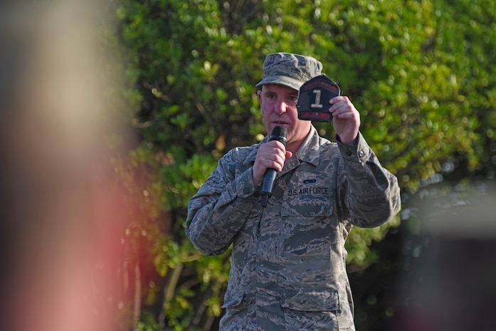 Airman 1st Class William Lemon, 8th Aircraft Maintenance Squadron member, talks about the morning of Sept. 11, 2001, and his duty as a volunteer firefighter to respond to the attacks in New York City during the September 11 Remembrance ceremony at Kunsan Air Base, Republic of Korea, Sept. 11, 2019. Lemon was a member of the Brentwood Fire Department for nearly 20 years and was one of the first responders called to duty 18 years ago on Sept. 11, 2001, before enlisting in the Air Force in 2017. (U.S. Air Force photo by Staff Sgt. Mackenzie Mendez)