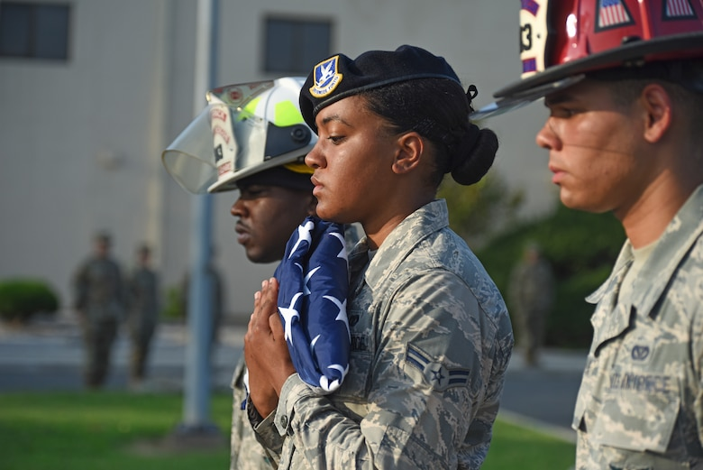U.S. Air Force Airman 1st Class Aubrey Mathis, 8th Security Forces Squadron member, carries the folded American flag during the September 11 Remembrance ceremony at Kunsan Air Base, Republic of Korea, Sept. 11, 2019. The ceremony was held in remembrance of the 2,977 people who lost their lives on Sept. 11, 2001, in New York City, Washington, D.C., and outside Shanksville, Pennsylvania. (U.S. Air Force photo by Staff Sgt. Mackenzie Mendez)