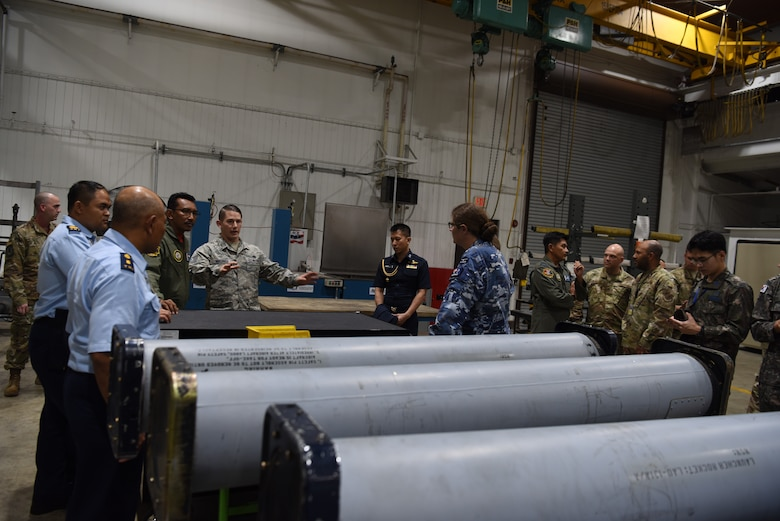 U.S. Air Force Tech. Sgt. Nicholas Mischiara, an armament maintenance floor supervisor assigned to the 51st Munitions Squadron, explains the capabilities and purpose of the back-shop to partner nations attending the 2019 Logistics and Safety Symposium held at Osan Air Base, Republic of Korea, Sept. 5, 2019.