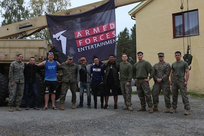 UFC fighters Sam Alvey, Gray Maynard, Ashlee Evans-Smith and Mark Munoz pose for a photo alongside U.S. Marines with Marine Rotational Force-Europe 19.2, Marine Forces Europe and Africa, during an Armed Forces Entertainment tour visit in Setermoen, Norway, Sep. 5, 2019