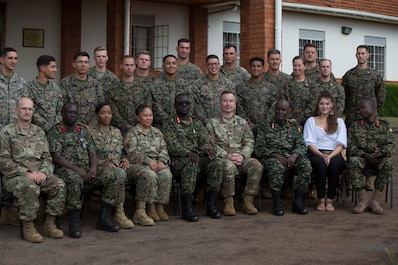 Uganda People's Defense Force Soldiers, a U.S. Embassy member, a U.S. Soldier, and U.S. Marines and Sailors with Special Purpose Marine Air-Ground Task Force-Crisis Response-Africa 19.2, Marines Forces Europe and Africa, pose for a group photo during a closing ceremony at Camp Jinja, Uganda, Aug. 30, 2019.
