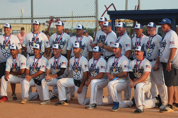 The U.S. Air Force's Men Softball Team poses for a group photo with their gold medals after winning the Armed Forces Softball Tournament at Naval Air Station Pensacola, Florida, Aug.12-17, 2019. Staff Sgt. Christopher Stephenson was one of two 693rd Intelligence, Surveillance and Reconnaissance Group members selected to play for the Air Force teams, comprised of the top one percent who try out. (Courtesy photo)