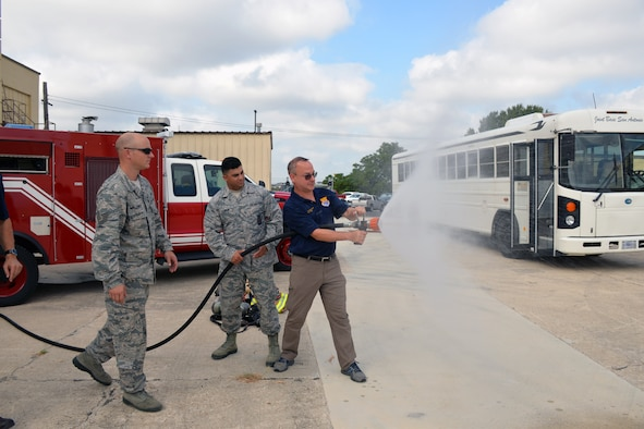 Steve Young, VIA Metropolitan Transit vice president of information technology, experiences discharging a fire hose during a tour of the 433rd Mission Support Group at Joint Base San Antonio-Lackland, Texas Sept. 7, 2019.