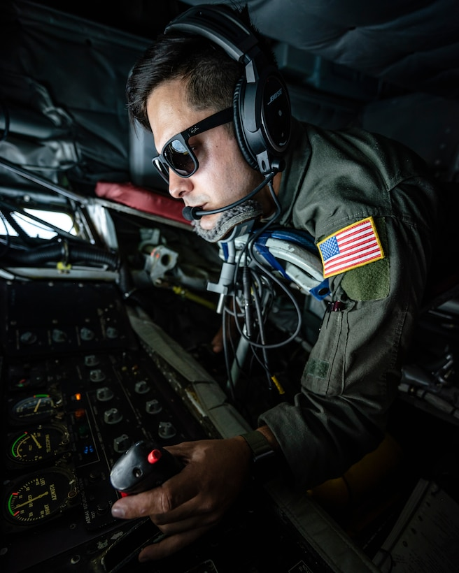 U.S. Air National Guard Senior Airman Dmitri Davila, 155th Air Refueling Wing in-flight refueling technician, operates the boom during an in-flight refuel of a German air force PA-200 Tornado during exercise Ample Strike 2019.
