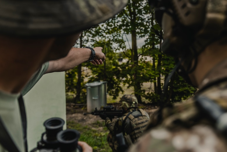 A Czech Republic Joint Terminal Attack Controller and U.S. Air Force Senior Airman Brandan Brown, 2nd Expeditionary Air Support Operations Squadron battalion TACP, search for the next opposing forces target to call for close air support during exercise Ample Strike 2019.