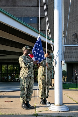 Chief Selects Deshawn Oliver and Nathaniel Pulcar raises the National Ensign during a Patriots Day ceremony at Norfolk Naval Shipyard Sept. 11, 2019.