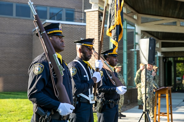 The Norfolk Naval Shipyard Police Color Guard stands ready to honor the fallen on Patriots Day Sept. 11.