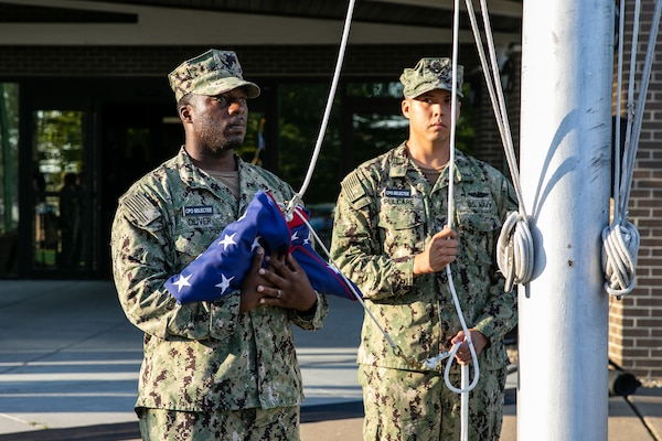 Chief Selects Deshawn Oliver and Nathaniel Pulcar prepare to raise the National Ensign during a Patriots Day ceremony at Norfolk Naval Shipyard Sept. 11, 2019.