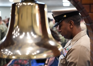 Chief Hospital Corpsman Darnell Mason bows his head for the invocation during a chief petty officer pinning ceremony held on board Naval Support Activity Bahrain. 39 Sailors from U.S. Naval Forces Central Command, Naval Support Activity Bahrain, and commands located throughout the U.S. 5th Fleet area of operations received their anchors.