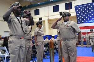 Chief Yeoman Justin Tilley renders a salute to the sideboys during a chief petty officer pinning ceremony held on board Naval Support Activity Bahrain. 39 Sailors from U.S. Naval Forces Central Command, Naval Support Activity Bahrain, and commands located throughout the U.S. 5th Fleet area of operations received their anchors.