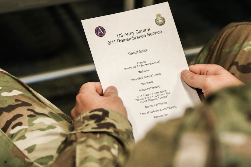 A Soldier reads the program for U.S. Army Central's Patriot Day service at USARCENT's headquarters, Patton Hall, Shaw Air Force Base, S.C., Sept. 11, 2019. The service allowed members of USARCENT to reflect and honor those whose lives were lost, and pay tribute to brave first responders.