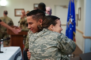 Airman Alfonso Santiago, 90th Medical Group medical technician and another Airman hug after a story telling event Sept. 10 2019, at F.E. Warren Air Force Base, Wyo. The event was hosted on Suicide Prevention Day and aimed to raise awareness about suicide prevention. (U.S. Air Force photo by Joseph Coslett)