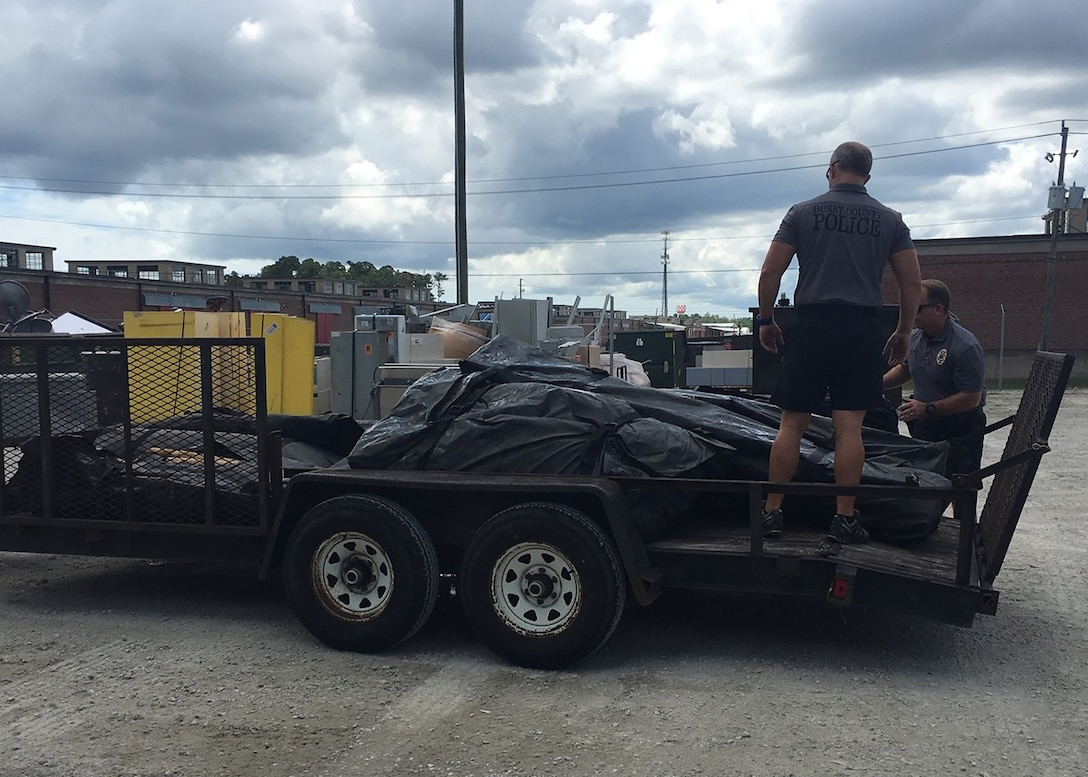 Horry County Police officers secure load the tents they obtained from DLA Disposition Services for hurricane preparations before heading back to South Carolina.