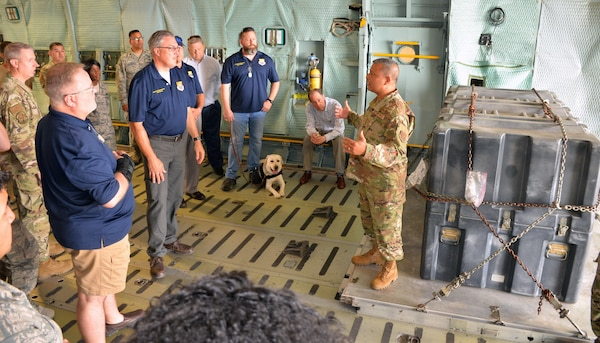 Chief Master Sgt. Vishal M. Rose, 74th Aerial Port Squadron superintendent of operations, talks to the honorary commanders about how the military airlift system moves cargo and passengers during the 433rd Mission Support Group at Joint Base San Antonio-Lackland Sept. 7.