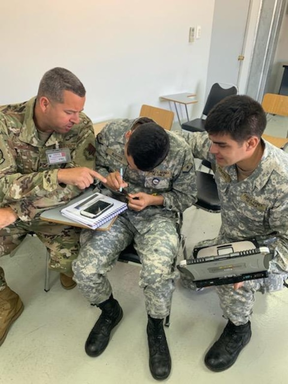 U.S. Air Force Tech. Sgt. Edgar Ayala, 366th Maintenance Squadron aerospace propulsion crafstman, teaches Chilean airmen technical orders August 26, 2019 at Cerro Moreno Air Base, Chile. Ayala was on a temporary duty where he helped ceritify15 Chilean airmen on how to perform repairs on F100-Pratt and Whitney-W220 jet engine fan blades. (Courtsey photo)